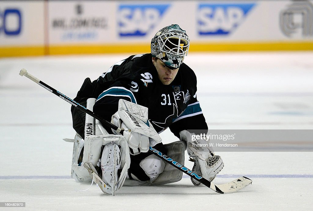 Goalkeeper Antti Niemi #31 of the San Jose Sharks stretches before an overtime shoot-out against the Edmonton Oilers at HP Pavilion on January 31, 2013 in San Jose, California.