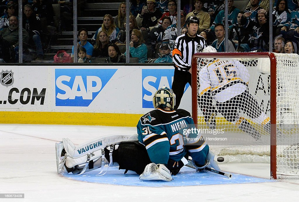 Goalkeeper Antti Niemi #31 of the San Jose Sharks watches the puck go into the goal as he gets beat by Craig Smith #15 of the Nashville Predartor in an overtime shoot-out at HP Pavilion on February 2, 2013 in San Jose, California. The Predators won the game 2-1 in the shoot-out.
