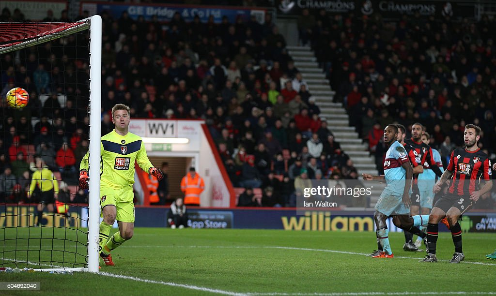 Goalkeeper <a gi-track='captionPersonalityLinkClicked' href=/galleries/search?phrase=Artur+Boruc&family=editorial&specificpeople=554761 ng-click='$event.stopPropagation()'>Artur Boruc</a> of Bournemouth watches the ball as <a gi-track='captionPersonalityLinkClicked' href=/galleries/search?phrase=Enner+Valencia&family=editorial&specificpeople=6898122 ng-click='$event.stopPropagation()'>Enner Valencia</a> of West Ham United (not pictured) scores their third goal during the Barclays Premier League match between A.F.C. Bournemouth and West Ham United at Vitality Stadium on January 12, 2016 in Bournemouth, England.