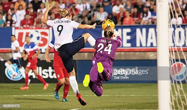 Goalkeeper Ashlyn Harris of the United States robs Eugenie Le Sommer of France of a goal during a game between France and the United States June 19...