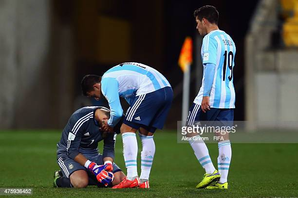 Goalkeeper Augusto Batalla Cristian Pavon and Emiliano Buendia of Argentina react after the FIFA U20 World Cup New Zealand 2015 Group B match between...