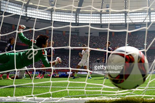 Goalkeeper Ayumi Kaihori of Japan is unable to save a shot by Carli Lloyd of the United States as Lloyd scores in the first half in the FIFA Women's...