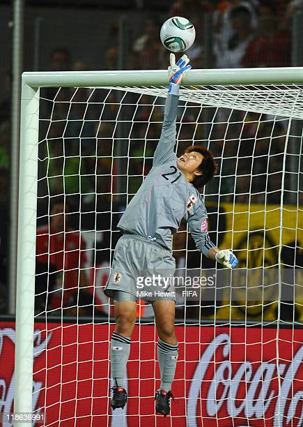 Goalkeeper Ayumi Kaihori of Japan makes a fine save during the FIFA Women's World Cup 2011 Quarter Final match between Germany and Japan at Arena IM...