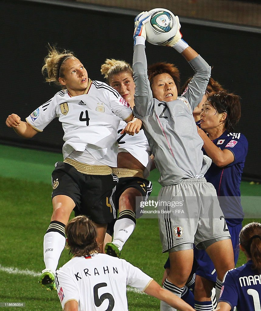 Goalkeeper Ayumi Kaihori (2ndR) of Japan saves a ball against Babett Peter (L) and Bianca Schmidt (2ndL) during the FIFA Women's World Cup quarter finals match between Germany and Japan on July 9, 2011 in Wolfsburg, Germany.