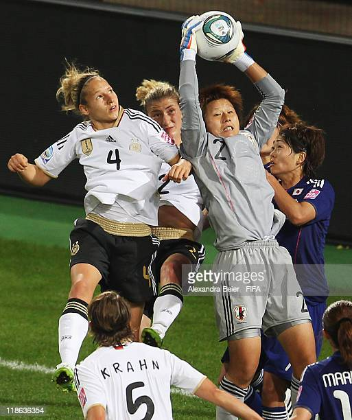 Goalkeeper Ayumi Kaihori of Japan saves a ball against Babett Peter and Bianca Schmidt during the FIFA Women's World Cup quarter finals match between...