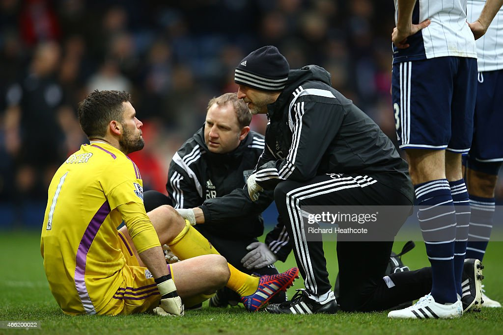 Goalkeeper <a gi-track='captionPersonalityLinkClicked' href=/galleries/search?phrase=Ben+Foster+-+Soccer+Player&family=editorial&specificpeople=5333104 ng-click='$event.stopPropagation()'>Ben Foster</a> of West Brom is attended to after being injured during the Barclays Premier League match between West Bromwich Albion and Stoke City at The Hawthorns on March 14, 2015 in West Bromwich, England.