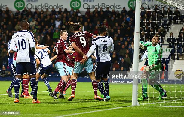 Goalkeeper Ben Foster of West Bromwich Albion looks on as James Tomkins of West Ham United scores their second goal during the Barclays Premier...