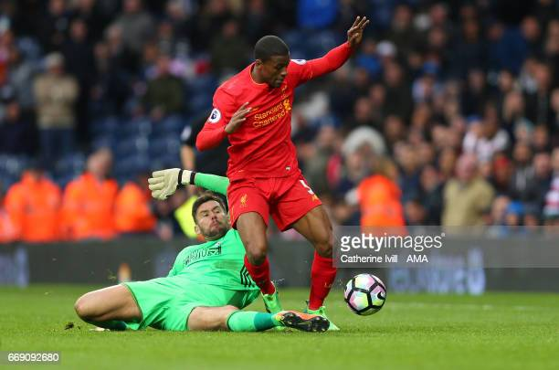 Goalkeeper Ben Foster of West Bromwich Albion tackles Georginio Wijnaldum of Liverpool during the Premier League match between West Bromwich Albion...