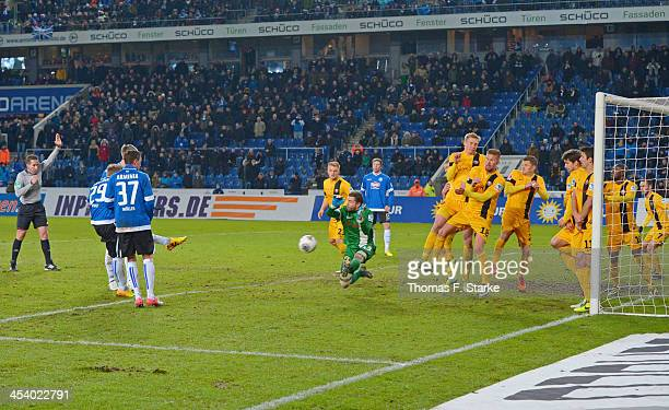 Goalkeeper Benjamin Kirsten of Dresden saves a free kick by Arne Feick of Bielefeld during the Second Bundesliga match between Arminia Bielefeld and...