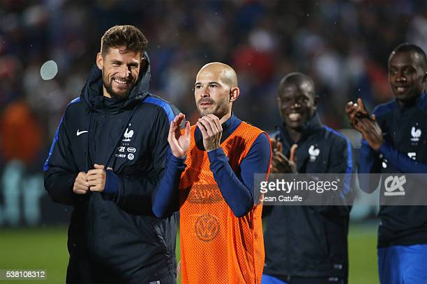 Goalkeeper Benoit Costil and Christophe Jallet of France greet the fans after the international friendly match between France and Scotland at Stade...