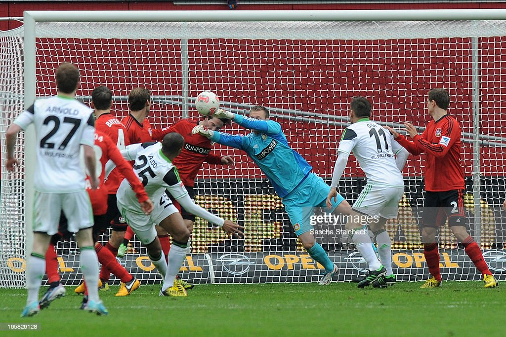 Goalkeeper Bernd Leno and Gonzalo Castro of Leverkusen save the ball on the line after a header from Naldo of Wolfsburg during the Bundesliga match between Bayer 04 Leverkusen and VfL Wolfsburg at BayArena on April 6, 2013 in Leverkusen, Germany.