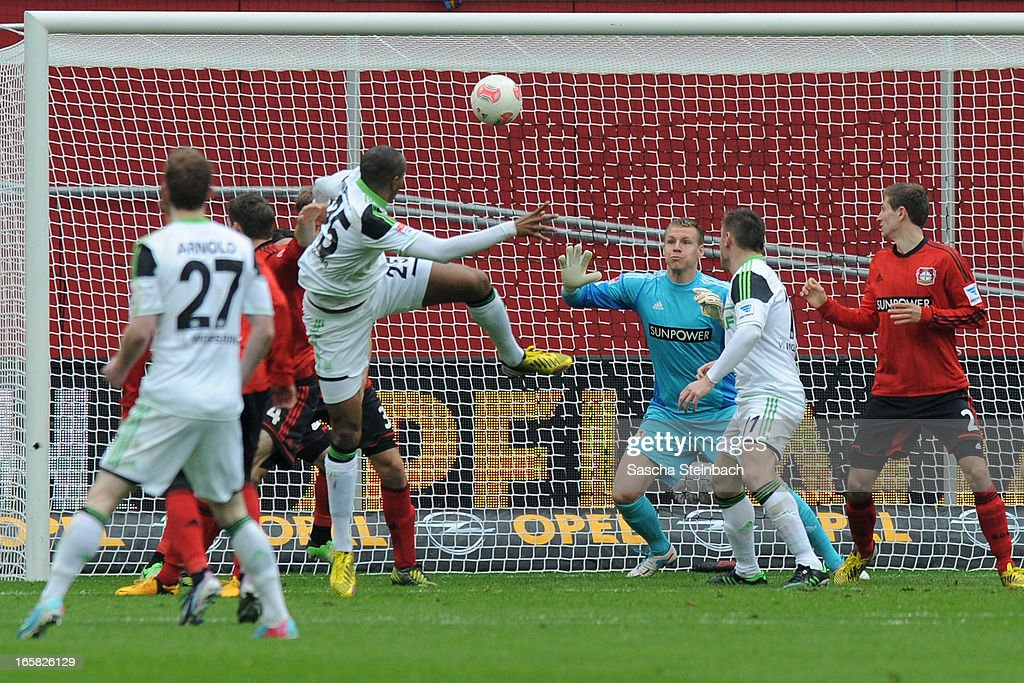 Goalkeeper <a gi-track='captionPersonalityLinkClicked' href=/galleries/search?phrase=Bernd+Leno&family=editorial&specificpeople=5528639 ng-click='$event.stopPropagation()'>Bernd Leno</a> and <a gi-track='captionPersonalityLinkClicked' href=/galleries/search?phrase=Gonzalo+Castro&family=editorial&specificpeople=605388 ng-click='$event.stopPropagation()'>Gonzalo Castro</a> of Leverkusen save the ball on the line after a header from Naldo of Wolfsburg during the Bundesliga match between Bayer 04 Leverkusen and VfL Wolfsburg at BayArena on April 6, 2013 in Leverkusen, Germany.