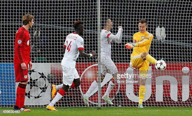 Goalkeeper Bernd Leno of Bayer Leverkusen kicks the ball out of his goal after Lucas Ocampos of Monaco celebrate his team's first goal during the...