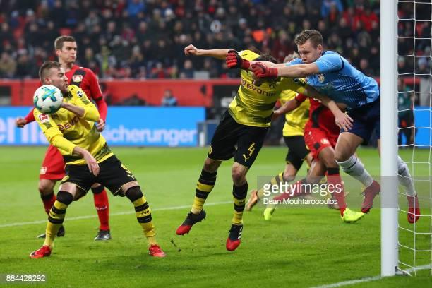 Goalkeeper Bernd Leno of Bayer Leverkusen saves against Neven Subotic of Dortmund during the Bundesliga match between Bayer 04 Leverkusen and...