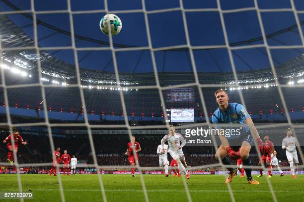 Goalkeeper Bernd Leno of Bayer Leverkusen watches the ball after Emil Forsberg of Leipzig scored a penalty goal to make it 12 during the Bundesliga...