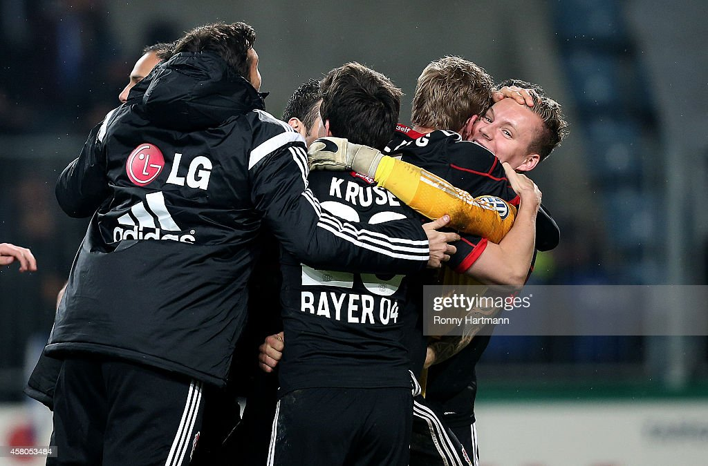 Goalkeeper <a gi-track='captionPersonalityLinkClicked' href=/galleries/search?phrase=Bernd+Leno&family=editorial&specificpeople=5528639 ng-click='$event.stopPropagation()'>Bernd Leno</a> (R) of Leverkusen celebrates with his team mates after the penalty shootout during the DFB Cup second round match between 1. FC Magdeburg and Werder Bremen at MDCC Arena on October 29, 2014 in Magdeburg, Germany.