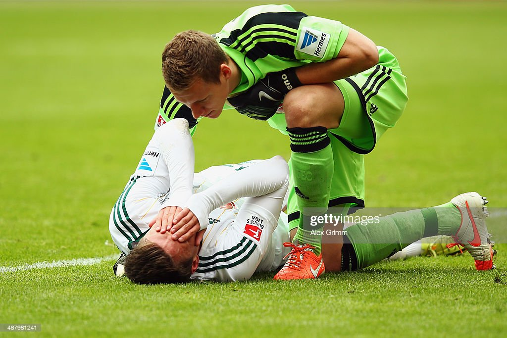 Goalkeeper <a gi-track='captionPersonalityLinkClicked' href=/galleries/search?phrase=Bernd+Leno&family=editorial&specificpeople=5528639 ng-click='$event.stopPropagation()'>Bernd Leno</a> of Leverkusen looks after team mate <a gi-track='captionPersonalityLinkClicked' href=/galleries/search?phrase=Sebastian+Boenisch&family=editorial&specificpeople=632472 ng-click='$event.stopPropagation()'>Sebastian Boenisch</a> during the Bundesliga match between Eintracht Frankfurt and Bayer Leverkusen at Commerzbank Arena on May 3, 2014 in Frankfurt am Main, Germany.