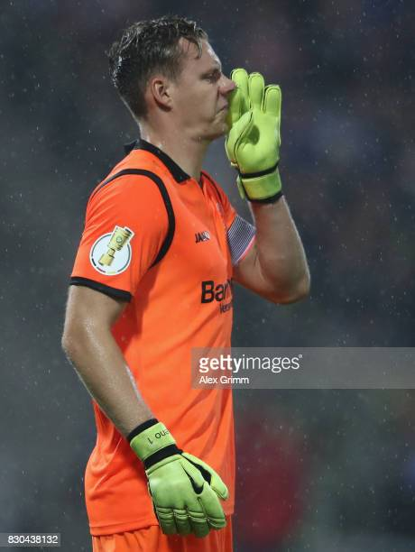 Goalkeeper Bernd Leno of Leverkusen reacts during the DFB Cup first round match between Karlsruher SC and Bayer Leverkusen at Wildparkstadion on...