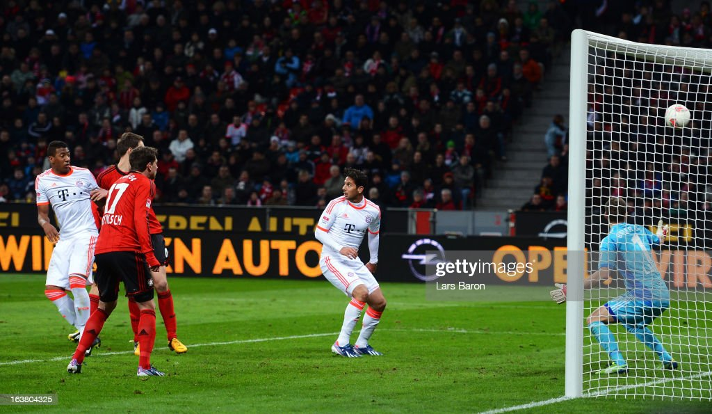 Goalkeeper <a gi-track='captionPersonalityLinkClicked' href=/galleries/search?phrase=Bernd+Leno&family=editorial&specificpeople=5528639 ng-click='$event.stopPropagation()'>Bernd Leno</a> of Leverkusen receives an own goal during the Bundesliga match between Bayer 04 Leverkusen and FC Bayern Muenchen at BayArena on March 16, 2013 in Leverkusen, Germany.