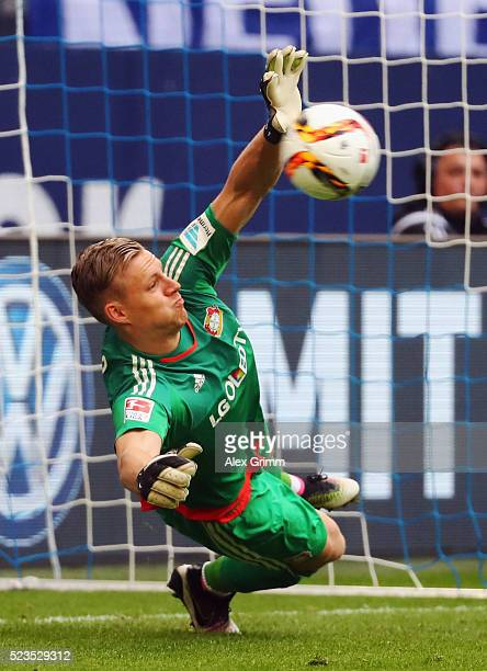 Goalkeeper Bernd Leno of Leverkusen saves a penalty from KlaasJan Huntelaar of Schalke during the Bundesliga match between FC Schalke 04 and Bayer...