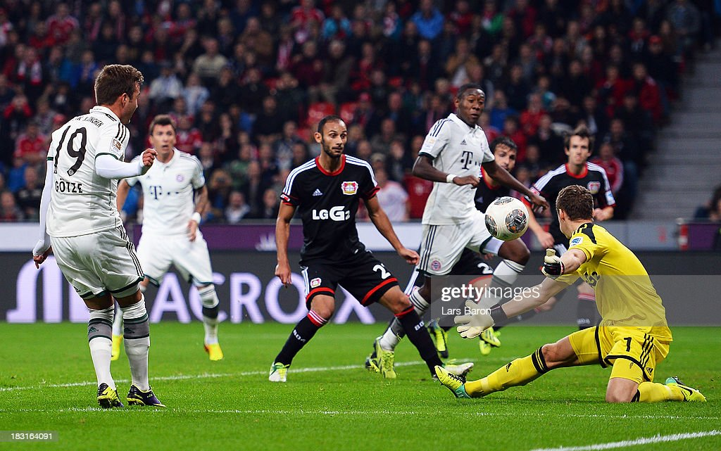 Goalkeeper Bernd Leno of Leverkusen saves a shoot of Mario Gomez of Muenchen during the Bundesliga match between Bayer Leverkusen and FC Bayern Muenchen at BayArena on October 5, 2013 in Leverkusen, Germany.