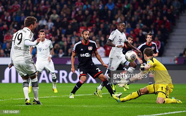 Goalkeeper Bernd Leno of Leverkusen saves a shoot of Mario Gomez of Muenchen during the Bundesliga match between Bayer Leverkusen and FC Bayern...