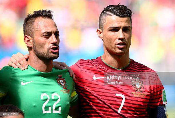 Goalkeeper Beto and Cristiano Ronaldo of Portugal sing the National Anthem prior to the 2014 FIFA World Cup Brazil Group G match between Portugal and...