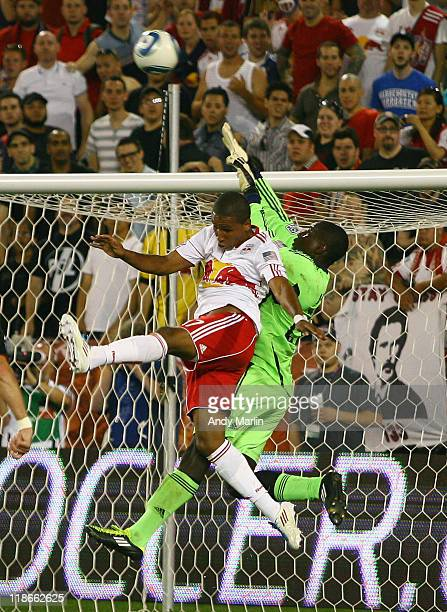 Goalkeeper Bill Hamid of DC United makes a save against Juan Agudelo of the New York Red Bulls during the game at Red Bull Arena on July 09 2011 in...