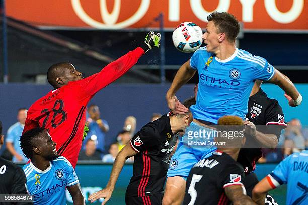 Goalkeeper Bill Hamid of DC United punches the ball away during the match vs New York City FC at Yankee Stadium on September 1 2016 in New York City...