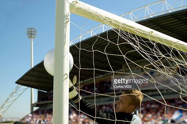 Goalkeeper Blocking Soccer Ball