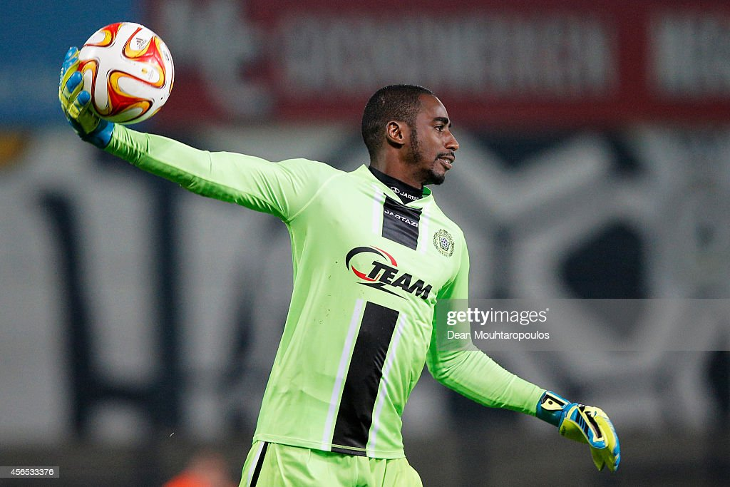 Goalkeeper, <a gi-track='captionPersonalityLinkClicked' href=/galleries/search?phrase=Boubacar+Barry&family=editorial&specificpeople=550738 ng-click='$event.stopPropagation()'>Boubacar Barry</a> of Lokeren throws the ball during the Group L UEFA Europa League match between Koninklijke Sporting Club Lokeren Oost Vlaanderen and FC Metalist Kharkiv held at Daknamstadion on October 2, 2014 in Lokeren, Belgium.