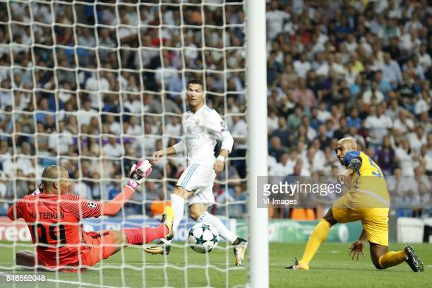 goalkeeper Boy Waterman of APOEL FC Cristiano Ronaldo of Real Madrid Carlao of APOEL FC 10 during the UEFA Champions League group H match between...