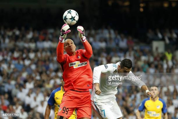 goalkeeper Boy Waterman of APOEL FC Cristiano Ronaldo of Real Madrid during the UEFA Champions League group H match between Real Madrid and APOEL FC...