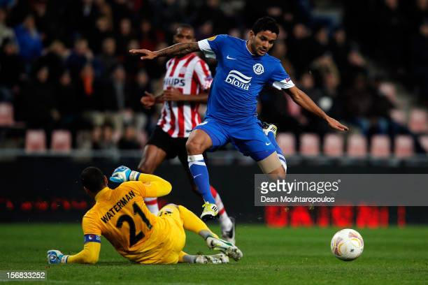 Goalkeeper Boy Waterman of PSV is beaten to the ball by Nascimento Leite Matheus of Dnipro during the UEFA Europa League Group F match between PSV...