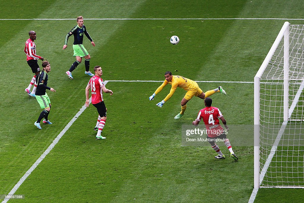 Goalkeeper, <a gi-track='captionPersonalityLinkClicked' href=/galleries/search?phrase=Boy+Waterman&family=editorial&specificpeople=2565381 ng-click='$event.stopPropagation()'>Boy Waterman</a> of PSV makes a save from <a gi-track='captionPersonalityLinkClicked' href=/galleries/search?phrase=Viktor+Fischer&family=editorial&specificpeople=7753634 ng-click='$event.stopPropagation()'>Viktor Fischer</a> (top) of Ajax during the Eredivisie match between PSV Eindhoven and Ajax Amsterdam at Philips Stadion on April 14, 2013 in Eindhoven, Netherlands.