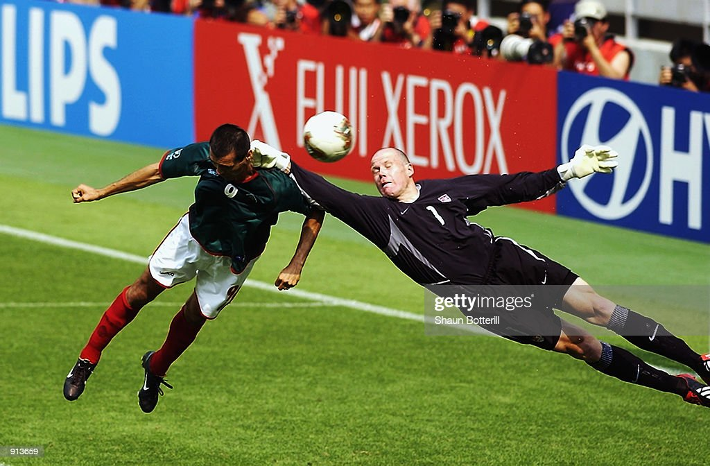 Goalkeeper Brad Friedel of the USA makes a save from Jared Borgetti of Mexico during the Mexico v USA, World Cup Second Round match played at the Jeonju World Cup Stadium, Jeonju, South Korea on June 17, 2002. The USA won 2-0.
