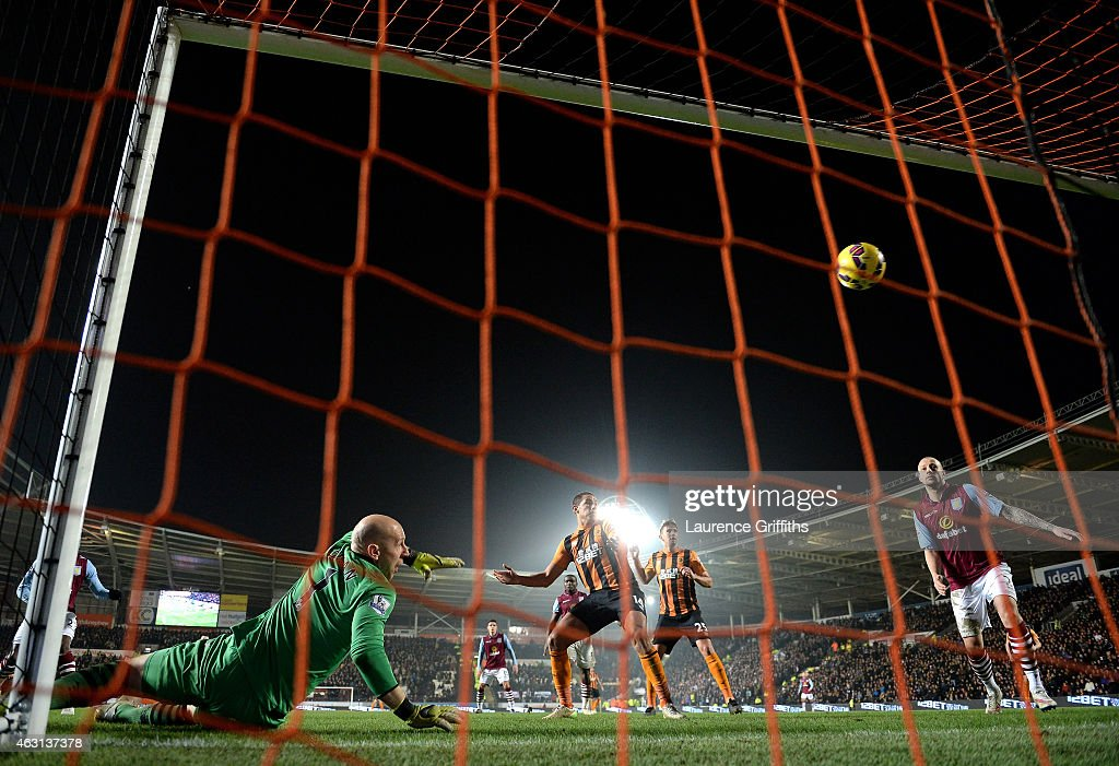 Goalkeeper <a gi-track='captionPersonalityLinkClicked' href=/galleries/search?phrase=Brad+Guzan&family=editorial&specificpeople=662127 ng-click='$event.stopPropagation()'>Brad Guzan</a> of Aston Villa looks in vain as <a gi-track='captionPersonalityLinkClicked' href=/galleries/search?phrase=Dame+N%27Doye&family=editorial&specificpeople=4891064 ng-click='$event.stopPropagation()'>Dame N'Doye</a> (not shown) of Hull City scores his team's second goal during the Barclays Premier League match between Hull City and Aston Villa at the KC Stadium on February 10, 2015 in Hull, England.