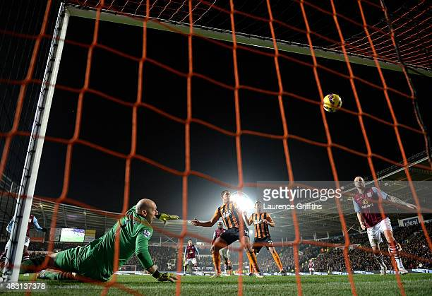 Goalkeeper Brad Guzan of Aston Villa looks in vain as Dame N'Doye of Hull City scores his team's second goal during the Barclays Premier League match...