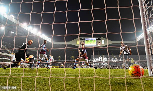 Goalkeeper Brad Guzan of Aston Villa looks on as Dele Alli of Tottenham Hotspur scores their second goal during the Barclays Premier League match...