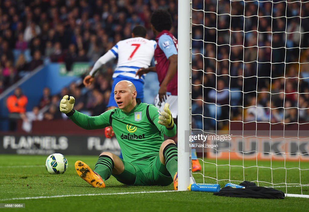 Goalkeeper <a gi-track='captionPersonalityLinkClicked' href=/galleries/search?phrase=Brad+Guzan&family=editorial&specificpeople=662127 ng-click='$event.stopPropagation()'>Brad Guzan</a> of Aston Villa reacts as Matt Phillips of QPR (7) scores their first goal during the Barclays Premier League match between Aston Villa and Queens Park Rangers at Villa Park on April 7, 2015 in Birmingham, England.