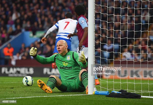 Goalkeeper Brad Guzan of Aston Villa reacts as Matt Phillips of QPR scores their first goal during the Barclays Premier League match between Aston...