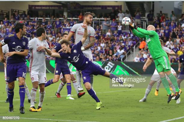 Goalkeeper Brad Guzan of Atlanta United makes a save against Jonathan Spector of Orlando City SC during a MLS soccer match between Atlanta United FC...