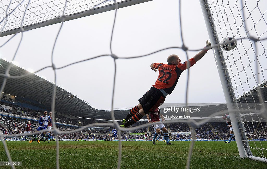 Goalkeeper <a gi-track='captionPersonalityLinkClicked' href=/galleries/search?phrase=Brad+Guzan&family=editorial&specificpeople=662127 ng-click='$event.stopPropagation()'>Brad Guzan</a> of Villa makes a save during the Barclays Premier League match between Reading and Aston Villa at Madejski Stadium on March 9, 2013 in Reading, England.