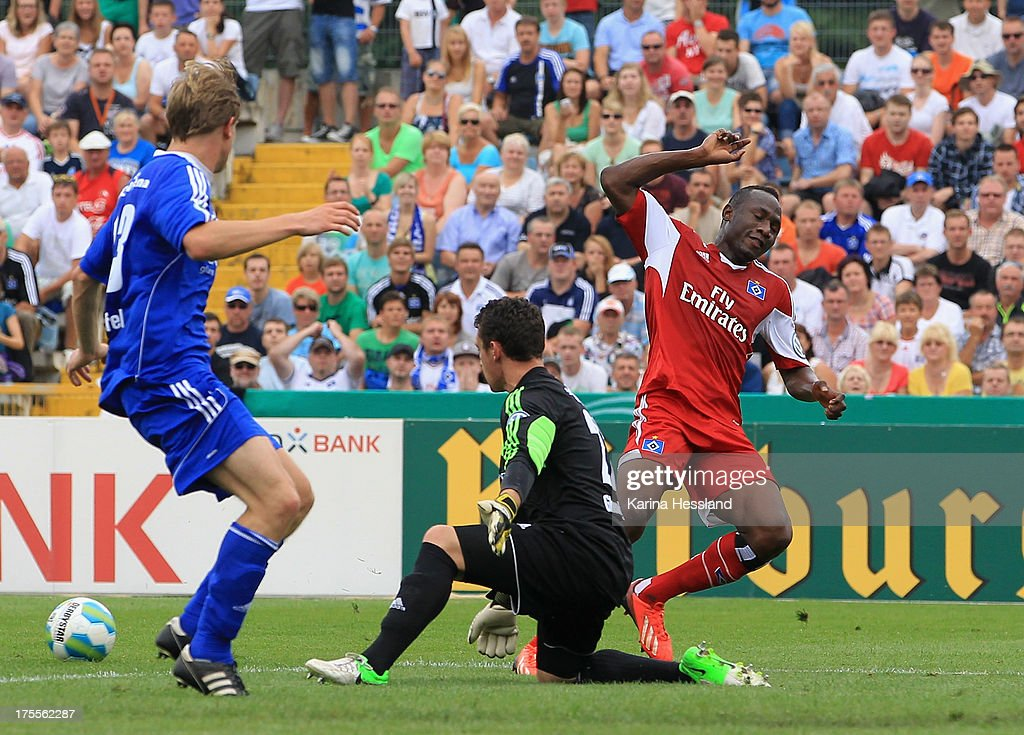 Goalkeeper Brian Gheorghiu of Jena challenges Jacques Daogari Zoua of Hamburg during the DFB Cup between SV Schott Jena and Hamburger SV at Ernst-Abbe-Sportfeld on August 04, 2013 in Jena,Germany.