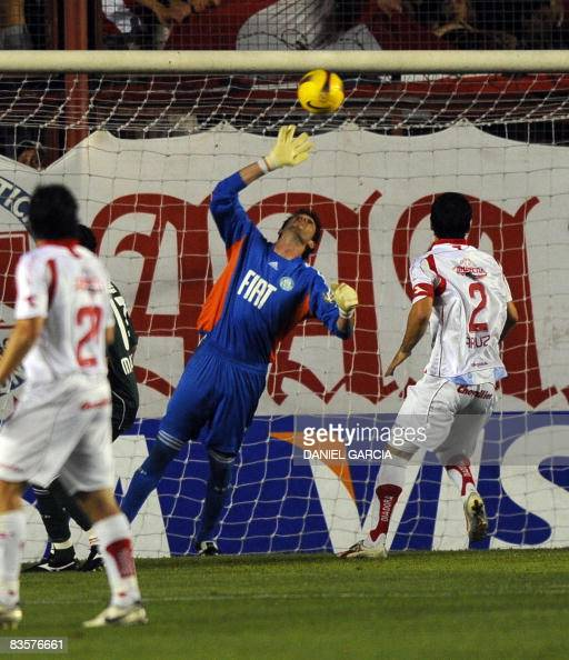 Goalkeeper Bruno of Brazilian Palmeiras fails to stop the ball kicked by Argentina's Argentinos Juniors defender Andres Scotti who so scores the...