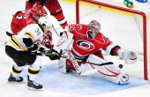 Goalkeeper Cam Ward of the Carolina Hurricanes stops a pointblank shot by Jordan Caron of the Boston Bruins during the third period at the RBC Center...