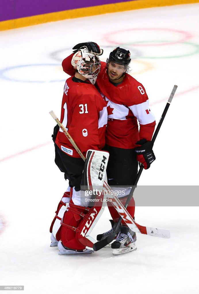 Goalkeeper <a gi-track='captionPersonalityLinkClicked' href=/galleries/search?phrase=Carey+Price&family=editorial&specificpeople=2222083 ng-click='$event.stopPropagation()'>Carey Price</a> #31 of Canada celebrates with teammate <a gi-track='captionPersonalityLinkClicked' href=/galleries/search?phrase=Drew+Doughty&family=editorial&specificpeople=2085761 ng-click='$event.stopPropagation()'>Drew Doughty</a> #8 after Canada beat Norway 3-1 during the Men's Ice Hockey Preliminary Round Group B game on day six of the Sochi 2014 Winter Olympics at Bolshoy Ice Dome on February 13, 2014 in Sochi, Russia.