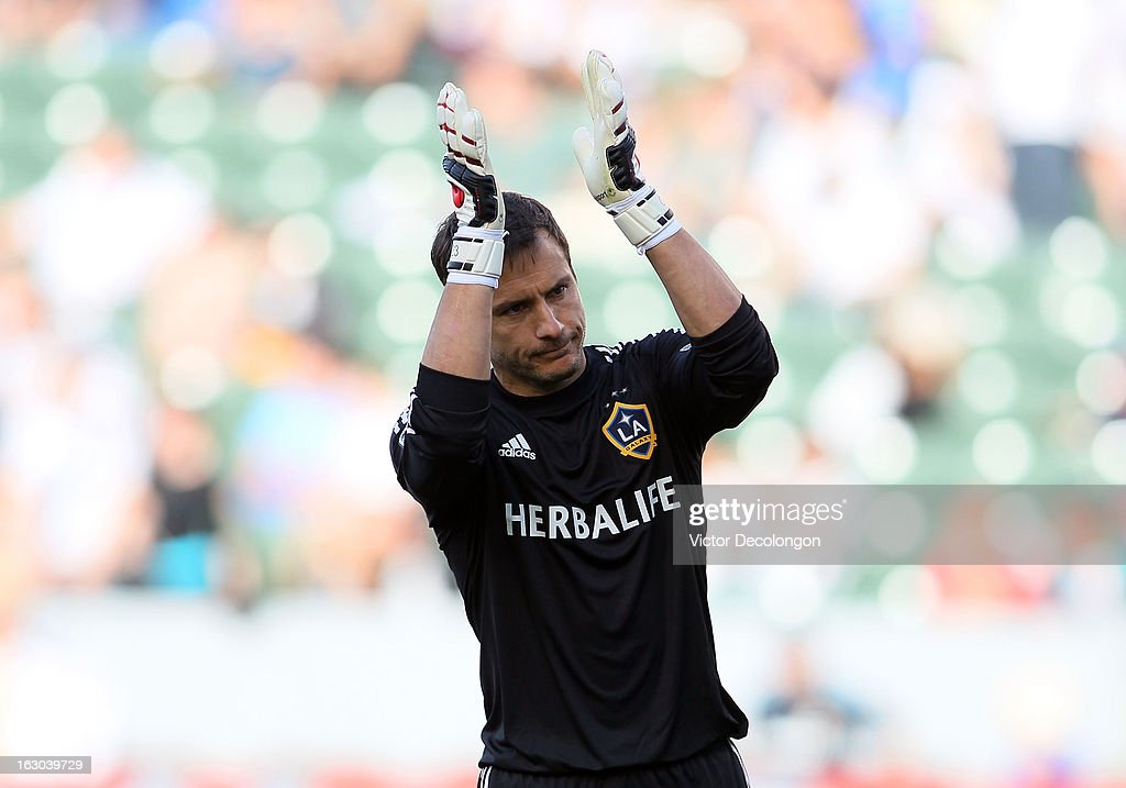 Goalkeeper <a gi-track='captionPersonalityLinkClicked' href=/galleries/search?phrase=Carlo+Cudicini&family=editorial&specificpeople=226724 ng-click='$event.stopPropagation()'>Carlo Cudicini</a> #23 of the Los Angeles Galaxy acknowledges the fans after their MLS match victory against the Chicago Fire at The Home Depot Center on March 3, 2013 in Carson, California. The Galaxy defeated the Fire 4-0.
