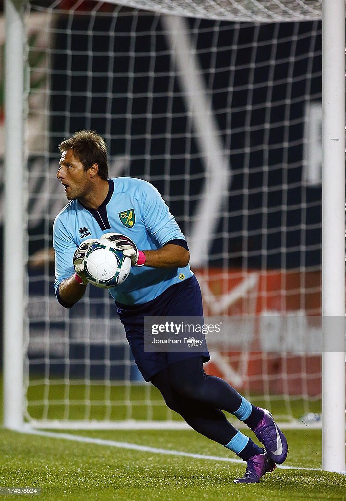 Goalkeeper <a gi-track='captionPersonalityLinkClicked' href=/galleries/search?phrase=Carlo+Nash&family=editorial&specificpeople=644740 ng-click='$event.stopPropagation()'>Carlo Nash</a> #13 of Norwich City makes a save against the Portland Timbers on July 24, 2013 at Jeld-Wen Field in Portland, Oregon.