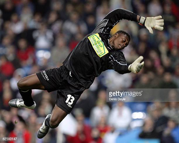 Goalkeeper Carlos Kameni of Espanyol tries to stop a shot by Real Madrid during a Primera Liga soccer match at the Bernabeu on February 5 2005 in...